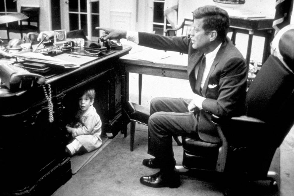 John F. Kennedy and John Jr. in the White House. Photograph by Liaison Agency, 1963.